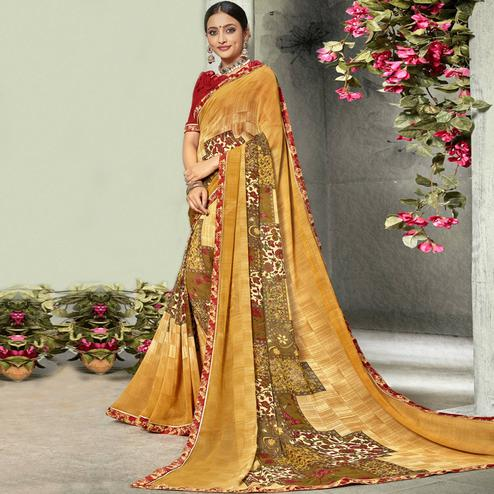 Imposing Orange Colored Casual Printed Georgette Saree