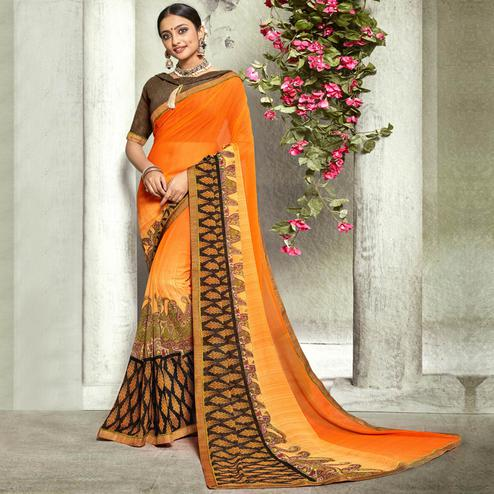 Pleasance Orange Colored Casual Printed Georgette Saree