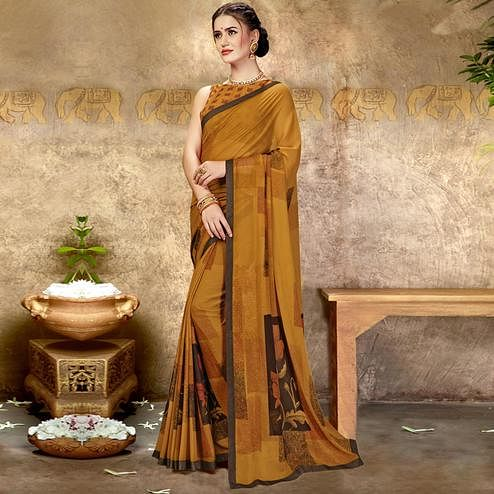 Desirable Rust Orange Colored Casual Printed Georgette Saree