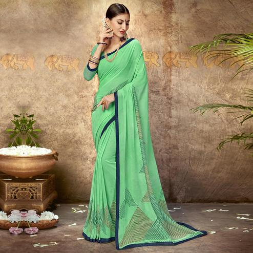 Pleasant Turquoise Green Colored Casual Printed Georgette Saree