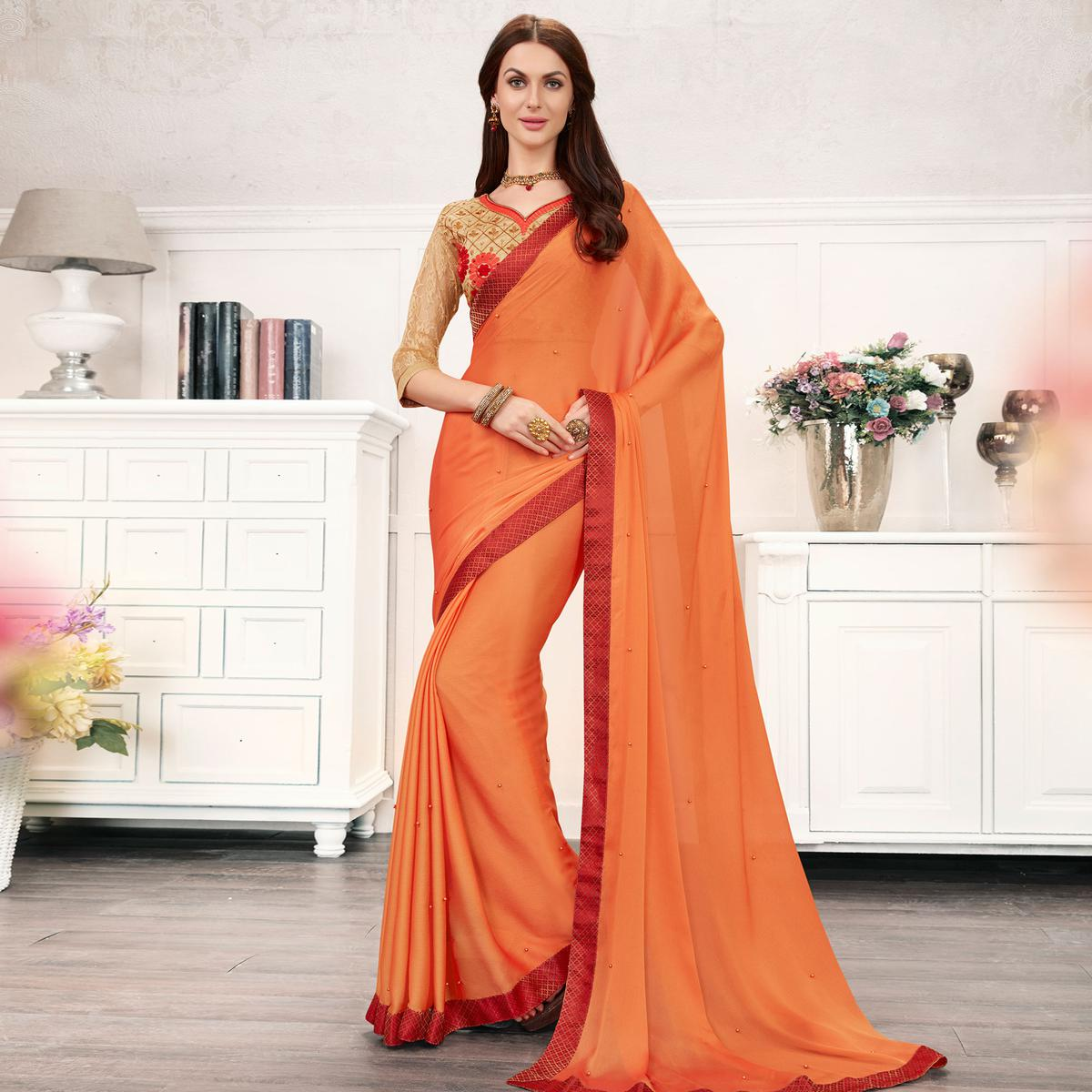 Innovative Peach Colored Partywear Embroidered Georgette Saree