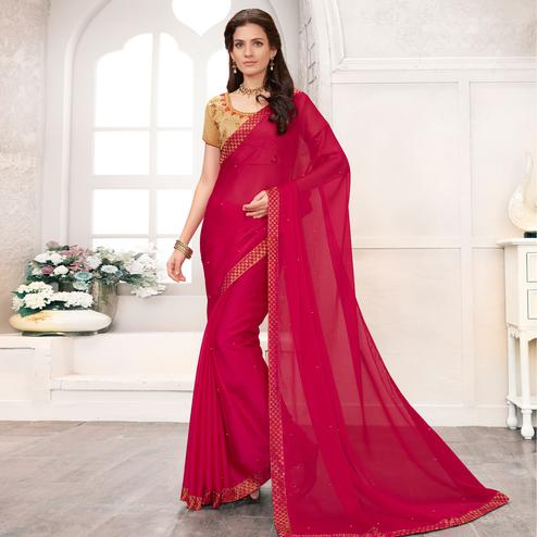Eye-catching Deep Pink Colored Partywear Embroidered Georgette Saree