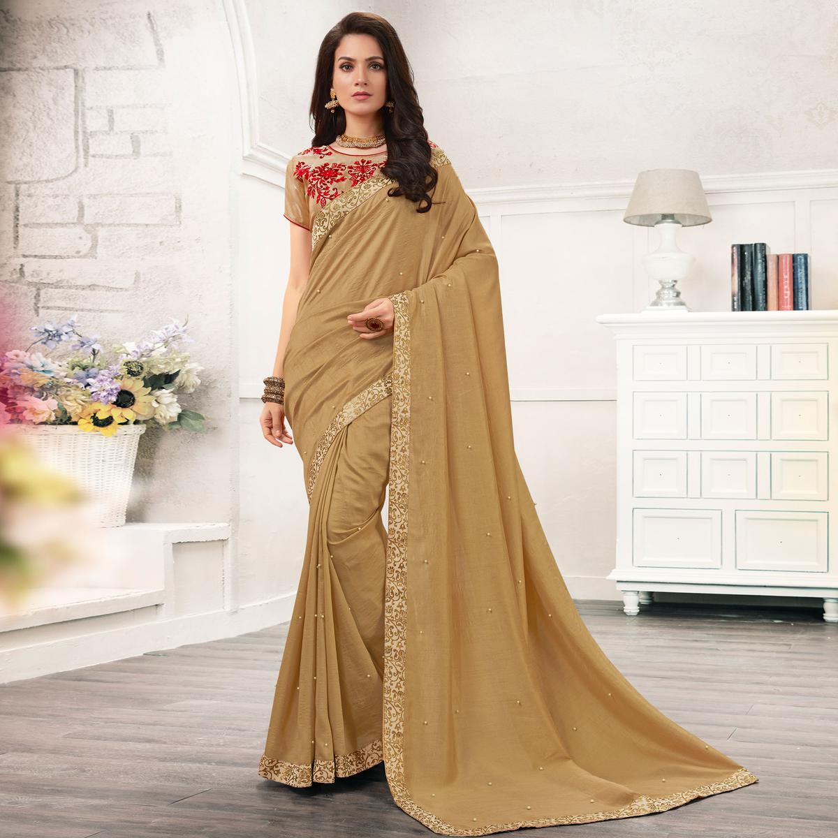 Gorgeous Chiku Colored Partywear Embroidered Georgette Saree