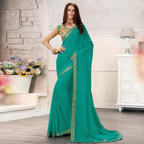 Ravishing Turquoise Green Colored Partywear Embroidered Georgette Saree