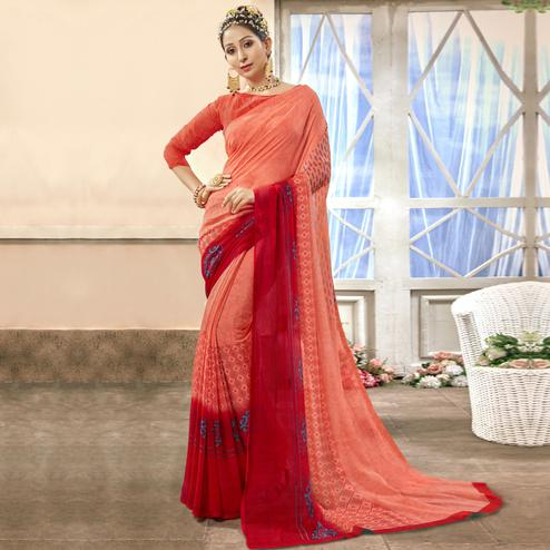 Graceful Peach Colored Casual Printed Chiffon Saree