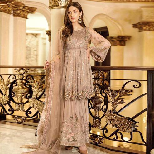 Capricious Beige Colored Partywear Embroidered Georgette Palazzo Suit