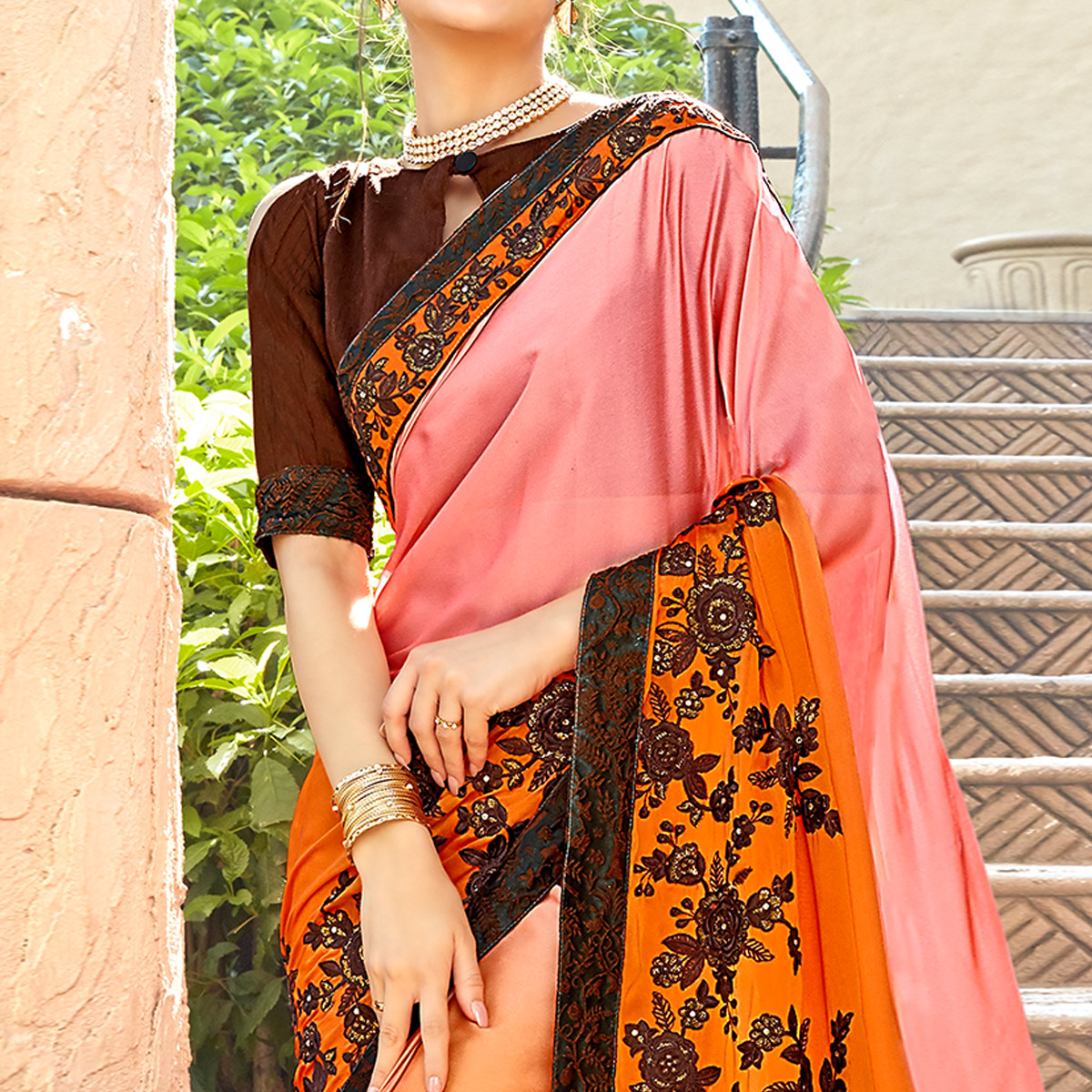 Attractive Orange-Peach Colored Partywear Embroidered Georgette Saree