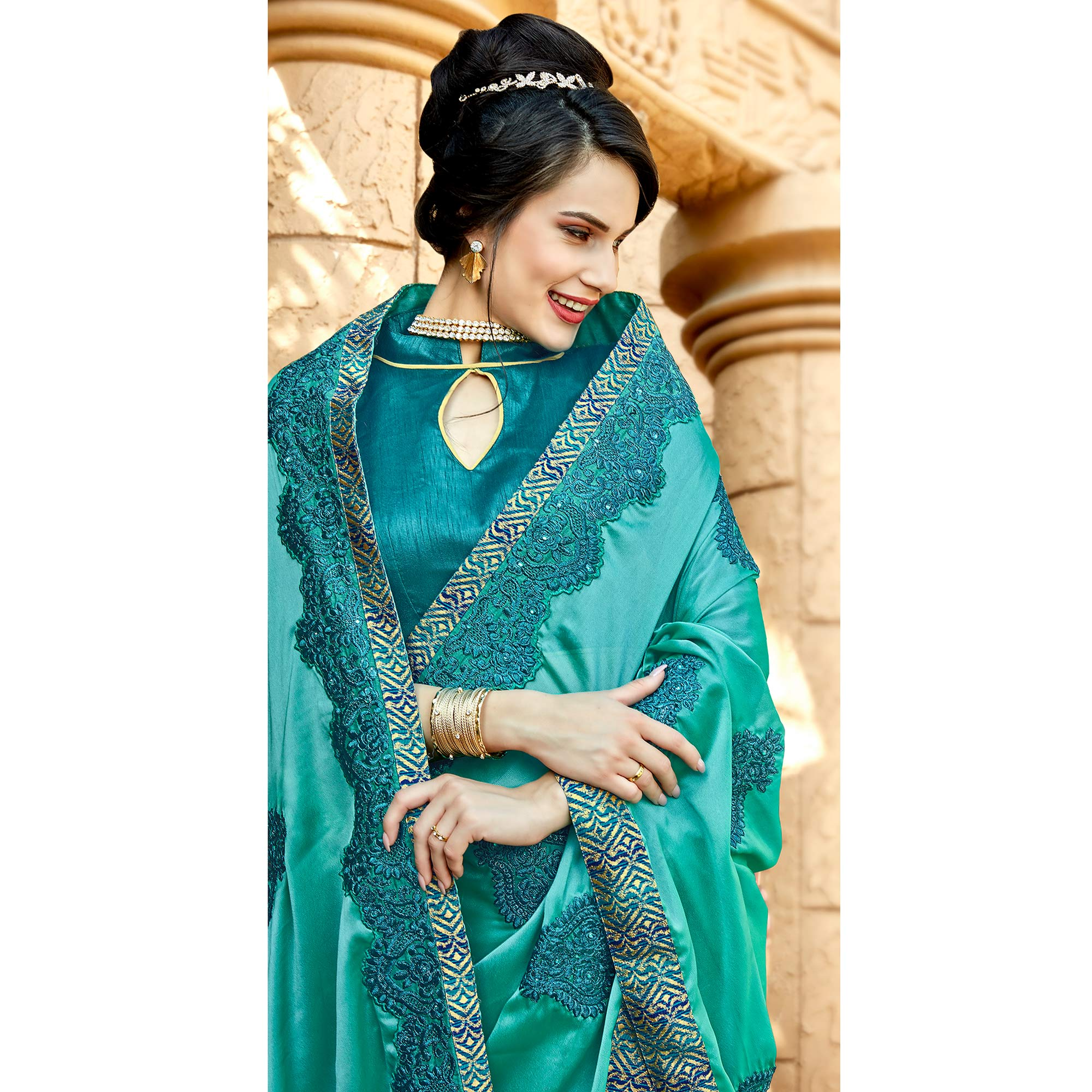Beautiful Rama Blue Colored Partywear Embroidered Georgette Saree