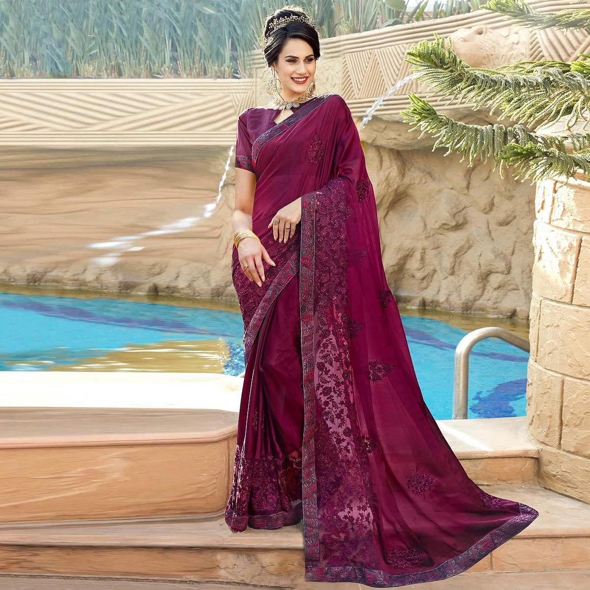 Graceful Purple Colored Partywear Embroidered Georgette Saree
