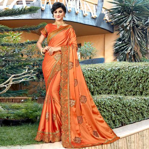 Jazzy Orange Colored Partywear Embroidered Georgette Saree
