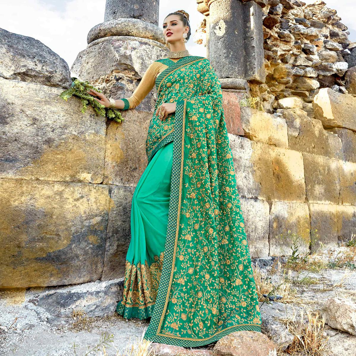 Innovative Turquoise Green Colored Partywear Embroidered Georgette Saree