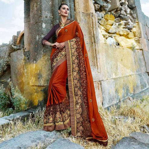 Eye-catching Rust Orange Colored Partywear Embroidered Georgette Saree