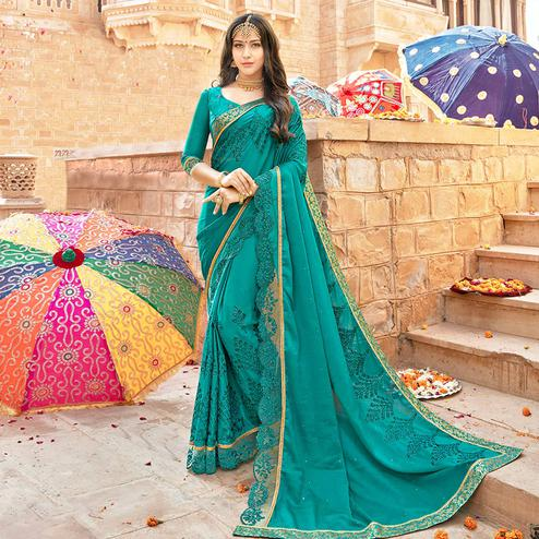 Ravishing Dark Turquoise Green Colored Partywear Embroidered Georgette Saree
