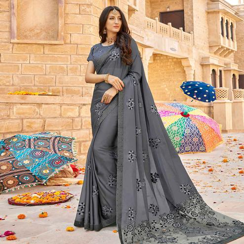 Surpassing Gray Colored Partywear Embroidered Georgette Saree