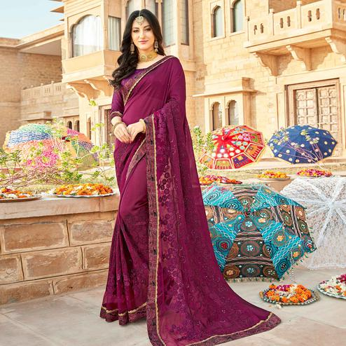 Intricate Dark Magenta Pink Colored Partywear Embroidered Georgette Saree