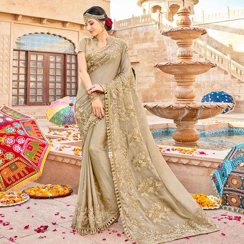 Arresting Chiku Colored Partywear Embroidered Georgette Saree