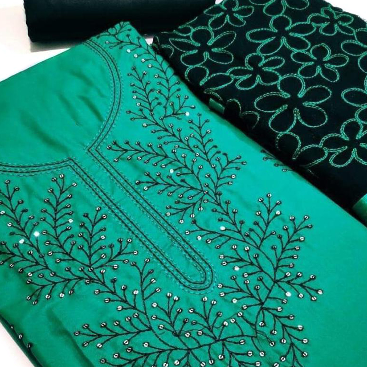 Pleasant Turquoise Green Colored Partywear Embroidered Cotton Dress Material