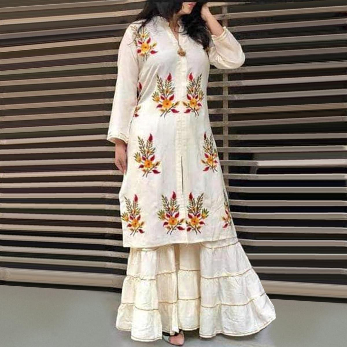 Glowing White Colored Partywear Embroidered Rayon Palazzo Suit