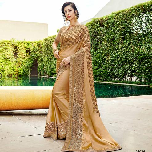 Impressive Beige Colored Partywear Embroidered Georgette Saree