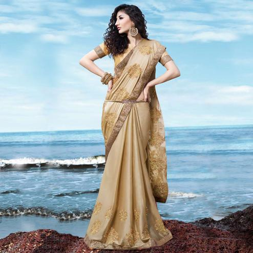 Attractive Beige Colored Partywear Embroidered Georgette Saree