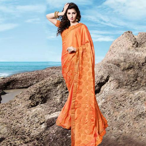 Graceful Orange Colored Partywear Embroidered Georgette Saree