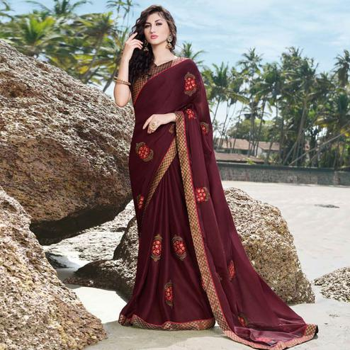 Blooming Dark Maroon Colored Partywear Embroidered Georgette Saree