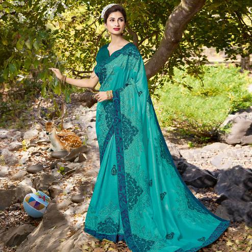 Innovative Aqua Blue Colored Partywear Embroidered Georgette Saree