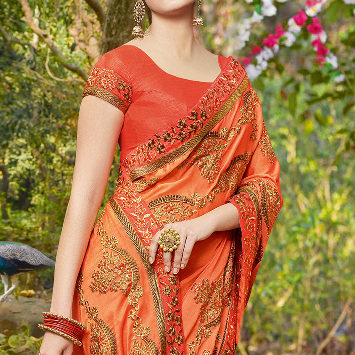 Amazing Orange Colored Partywear Embroidered Georgette Saree