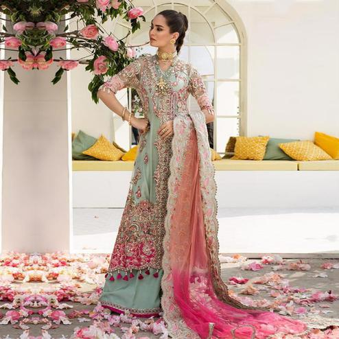 Entrancing Pastel Green Colored Partywear Embroidered Netted Palazzo Suit