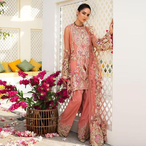 Prominent Pink Colored Partywear Embroidered Netted Palazzo Suit
