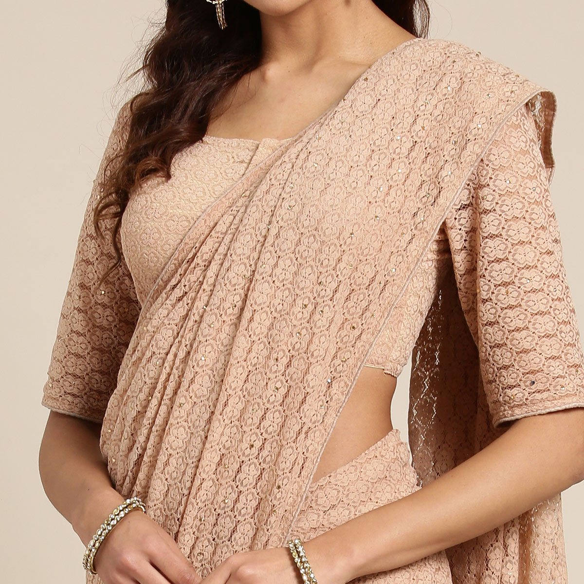 Innovative Beige Colored Partywear Net-Lycra Saree