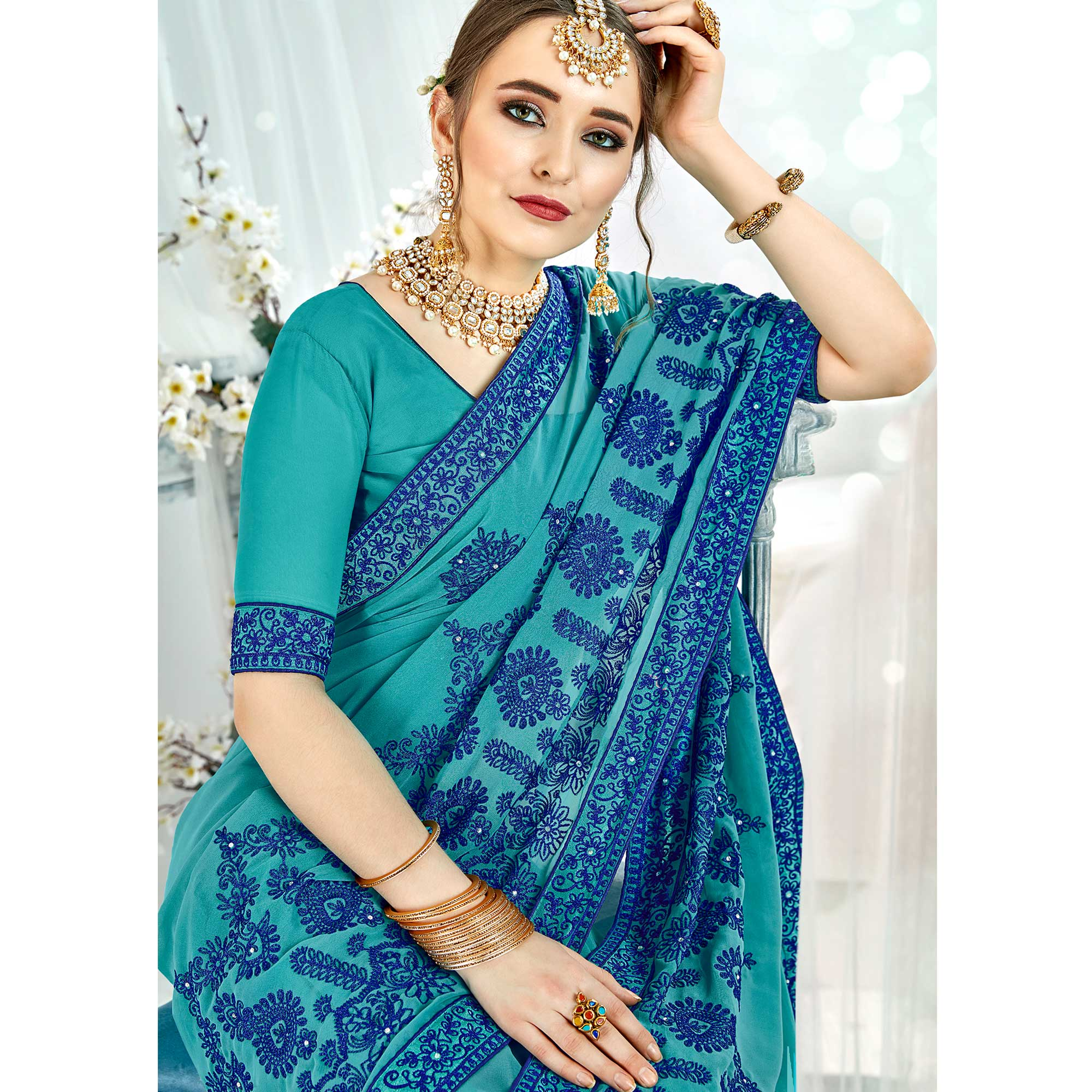 Flirty Blue Colored Partywear Embroidered Georgette Silk Saree