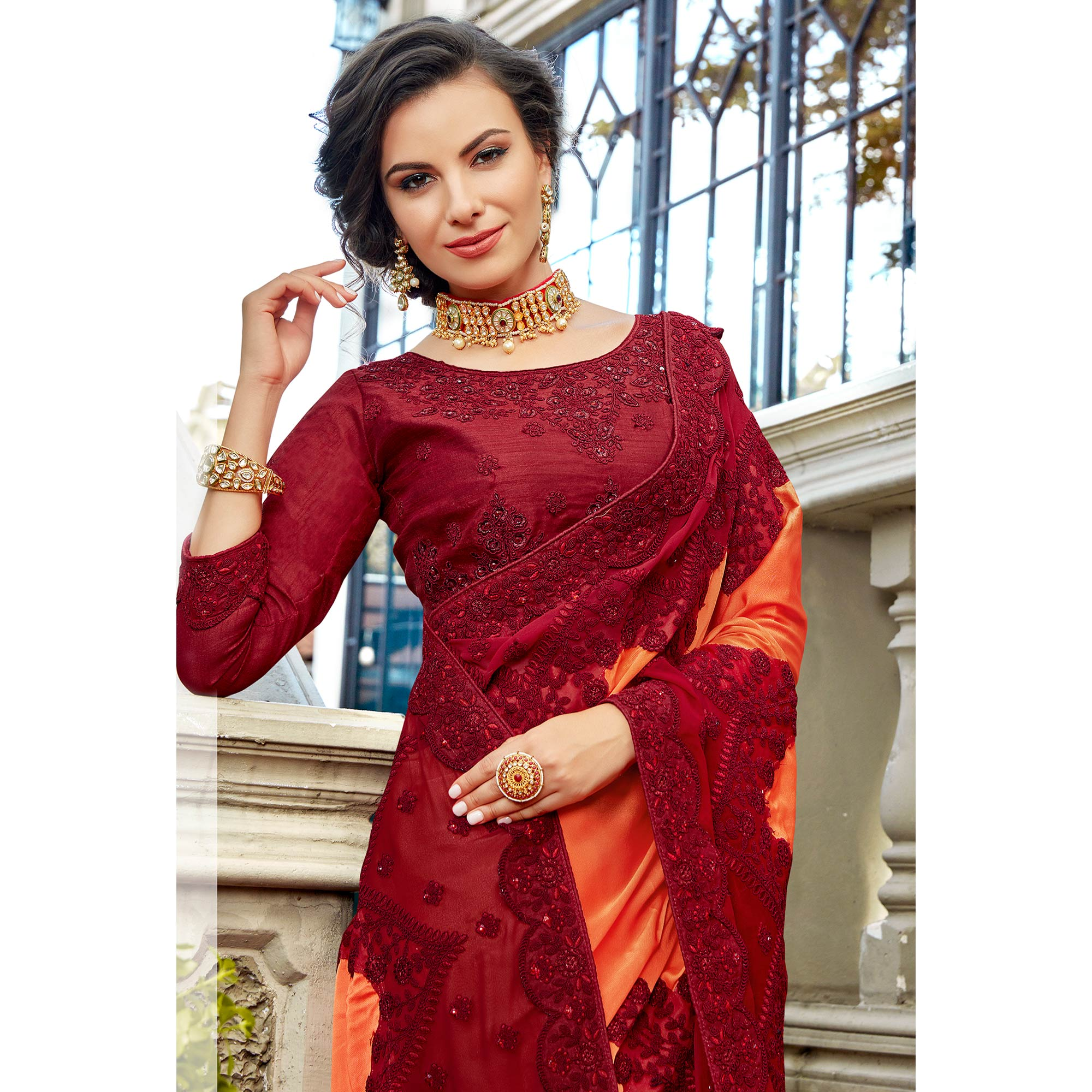 Delightful Peach-Maroon Colored Partywear Embroidered Georgette Silk Saree