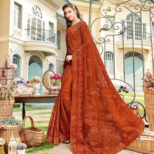 Fantastic Rust Orange Colored Partywear Embroidered Georgette Silk Saree