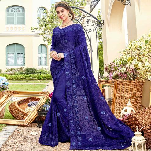 Gleaming Blue Colored Partywear Embroidered Georgette Silk Saree