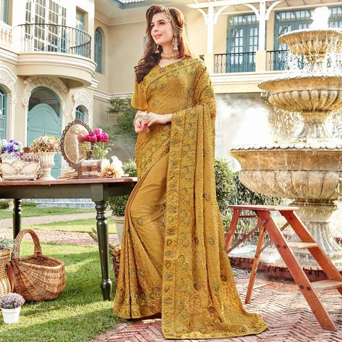Exceptional Beige Colored Partywear Embroidered Georgette Silk Saree