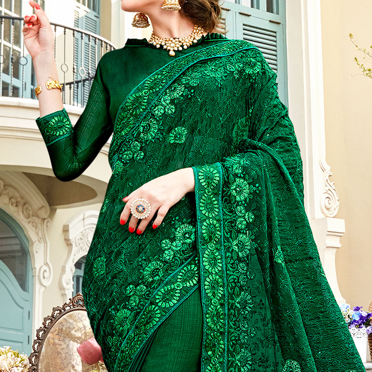 Magnetic Dark Green Colored Partywear Embroidered Georgette Silk Saree
