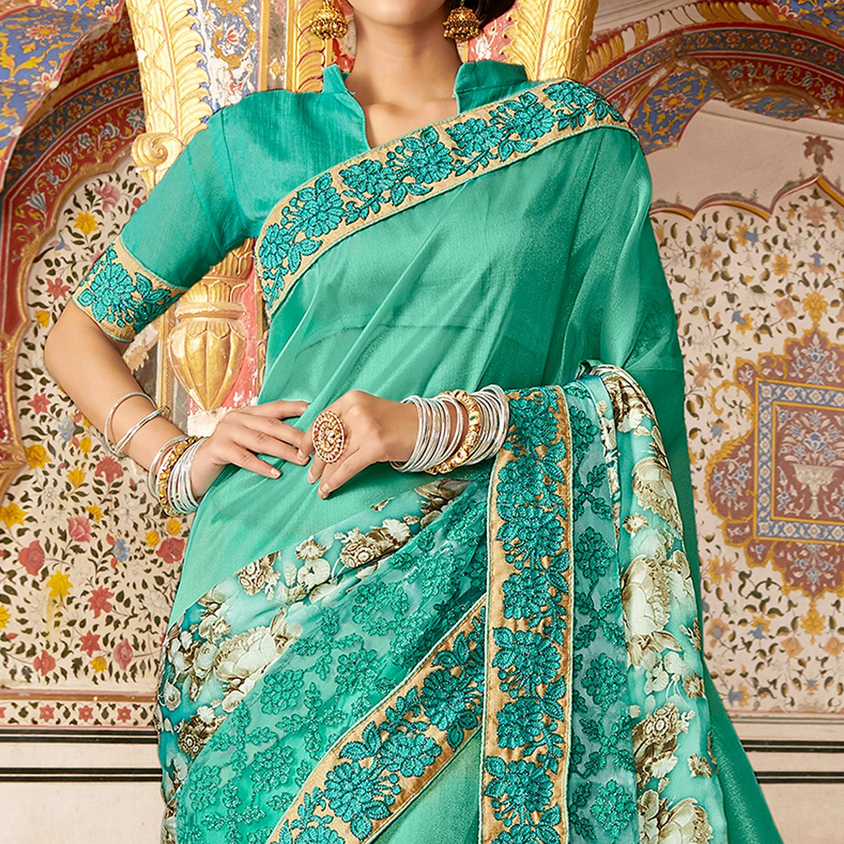 Capricious Turquoise Green Colored Partywear Embroidered Georgette Silk Saree