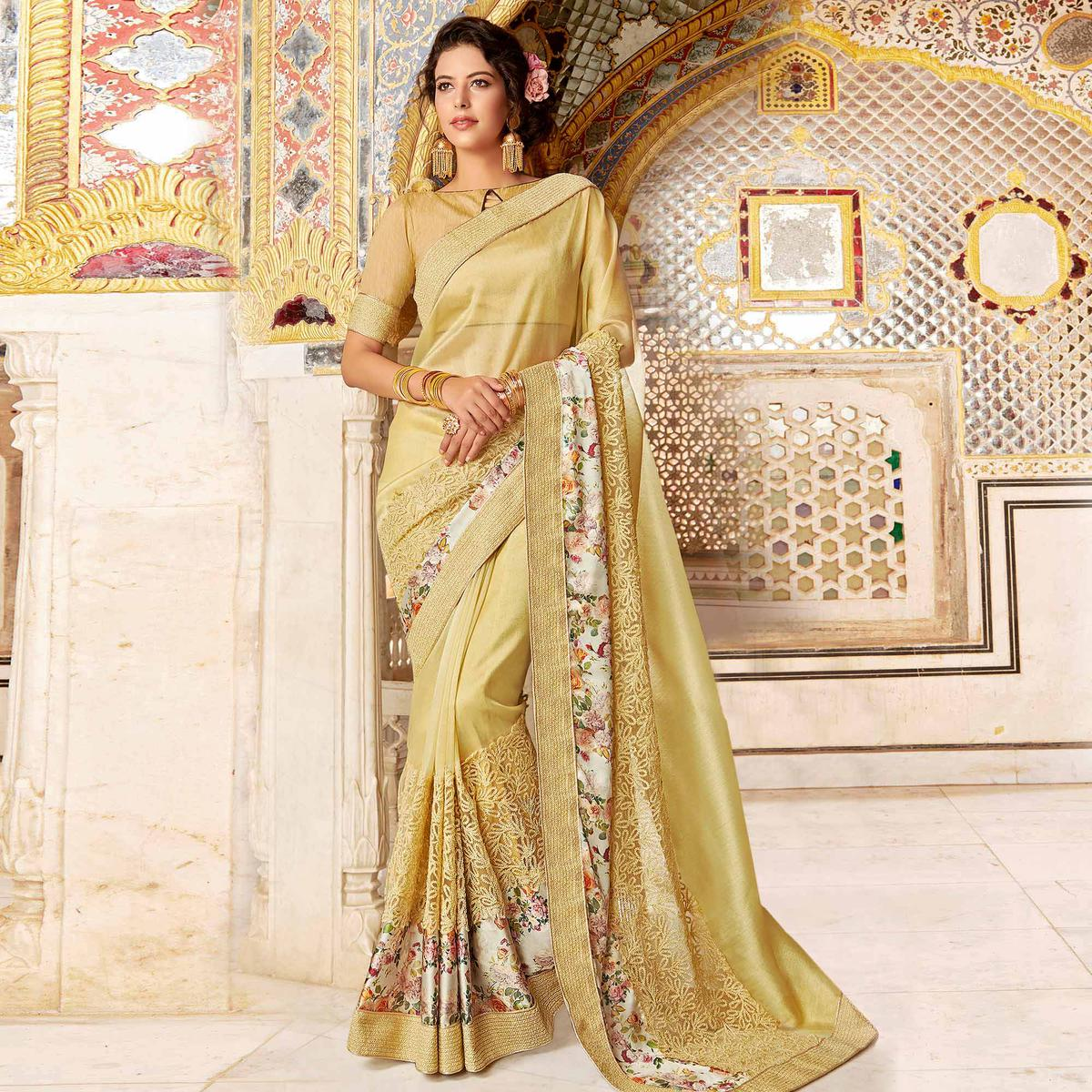Entrancing Beige Colored Partywear Embroidered Georgette Silk Saree
