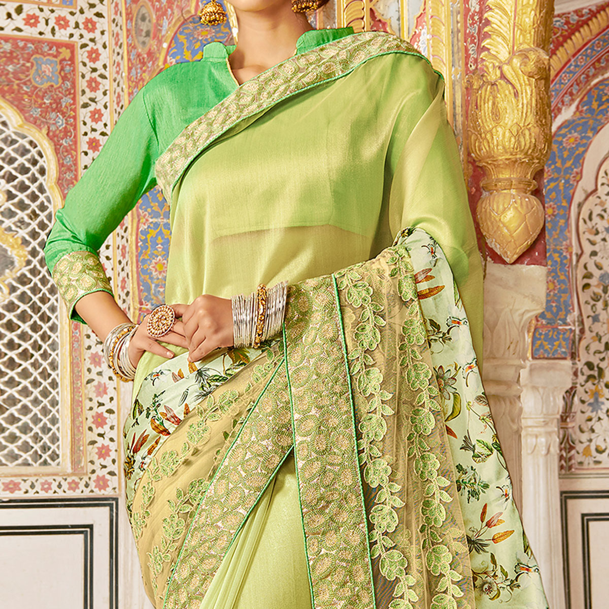 Prominent Green Colored Partywear Embroidered Georgette Silk Saree