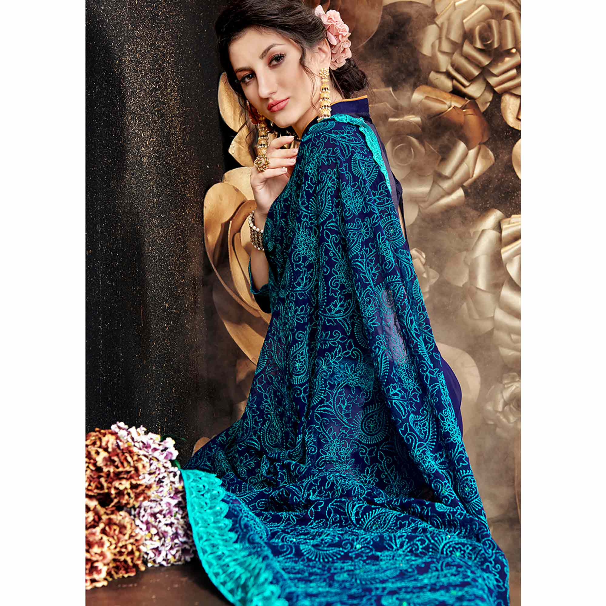 Mesmerising Blue Colored Partywear Embroidered Georgette Saree