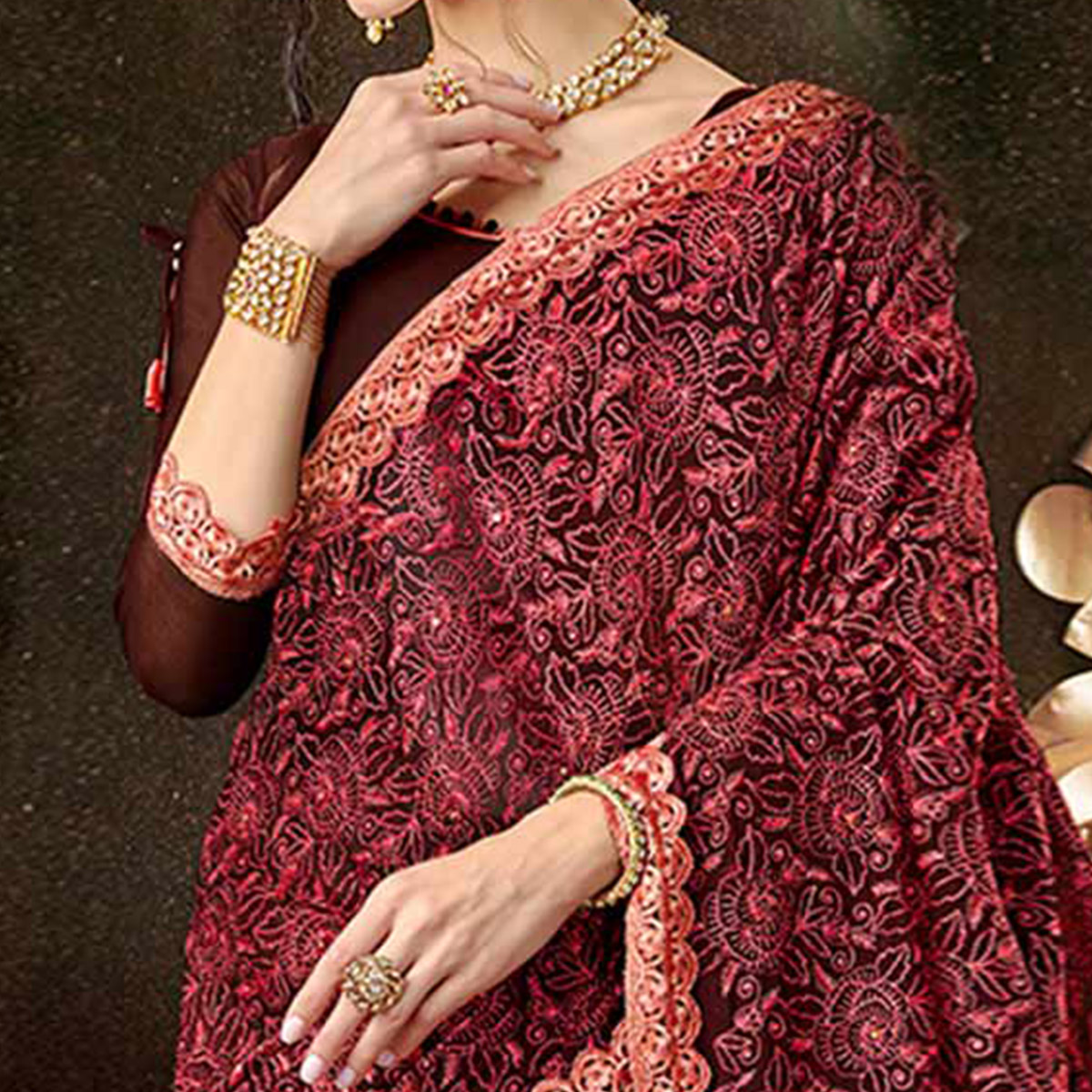 Staring Brown Colored Partywear Embroidered Georgette Saree