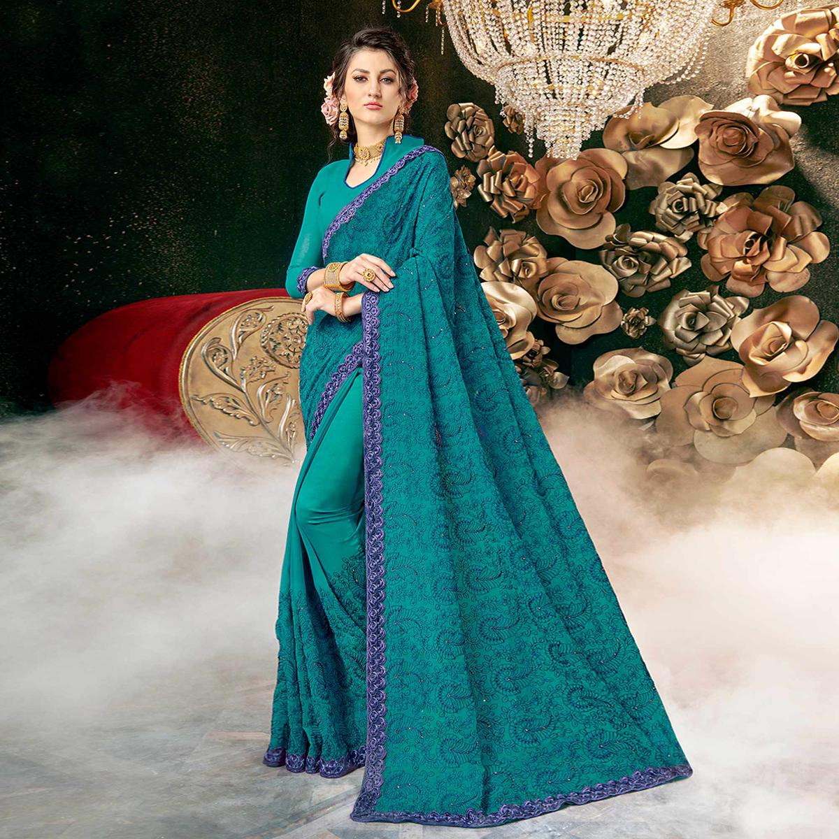Dazzling Rama Blue Colored Partywear Embroidered Georgette Saree