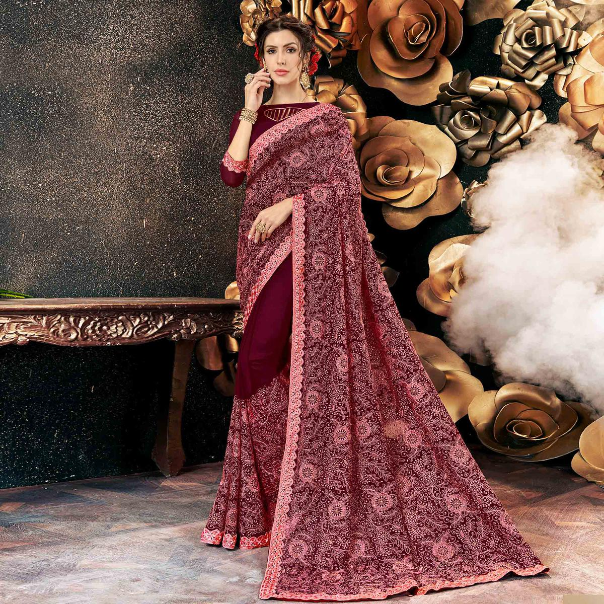 Surpassing Maroon Colored Partywear Embroidered Georgette Saree