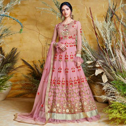 Delightful Pink Colored Partywear Embroidered Net Gown