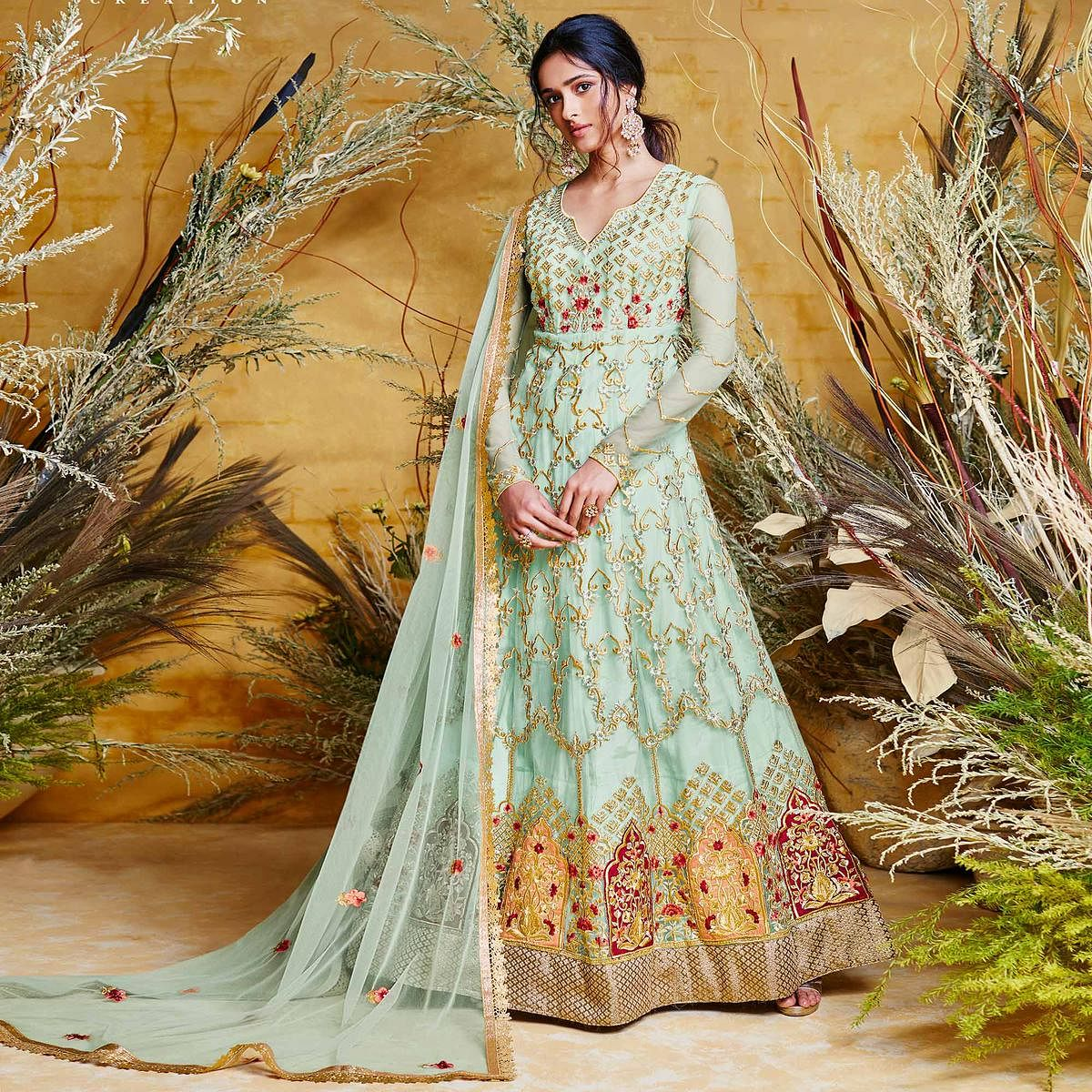 Engrossing Aqua Blue Colored Partywear Embroidered Net Gown