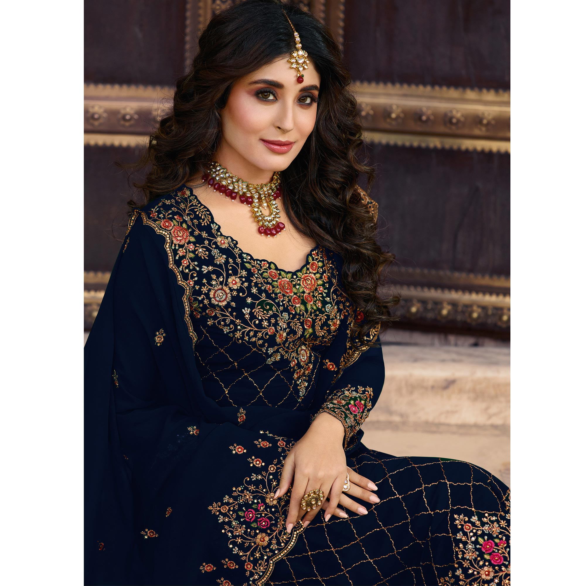 Refreshing Navy Blue Colored Partywear Embroidered Faux Georgette Suit