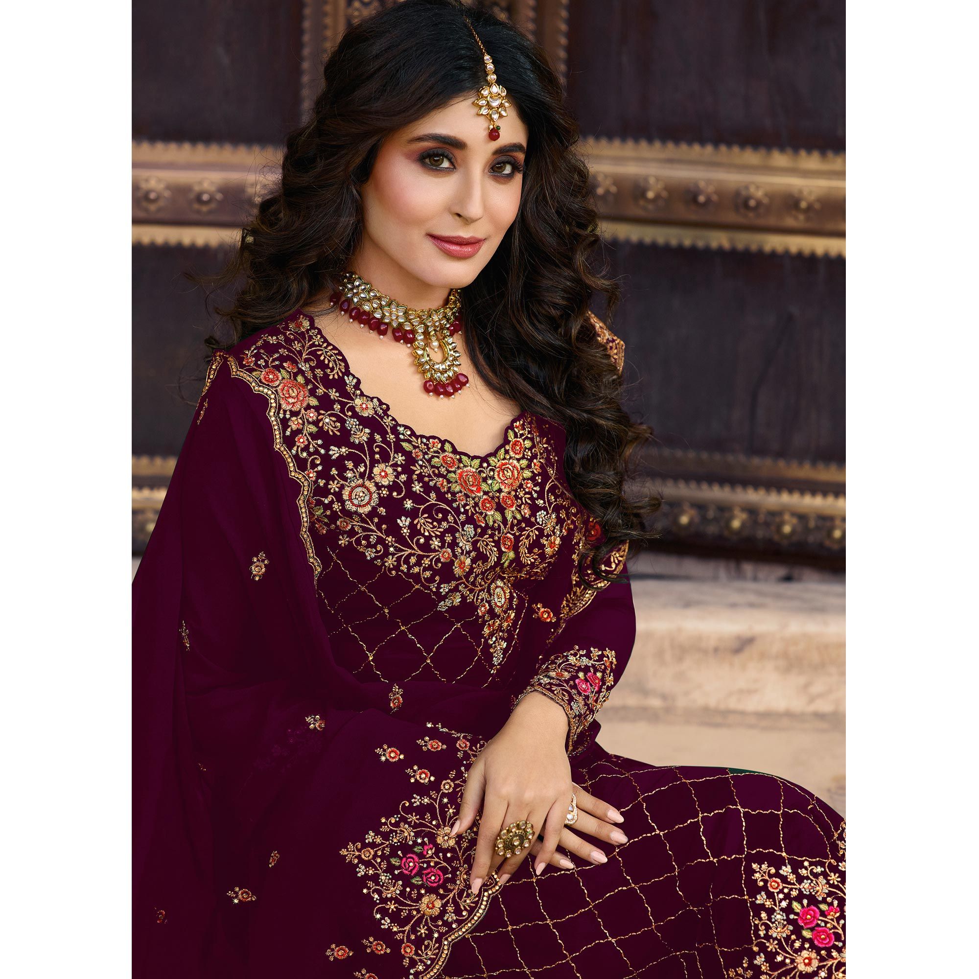 Magnetic Maroon Colored Partywear Embroidered Faux Georgette Suit