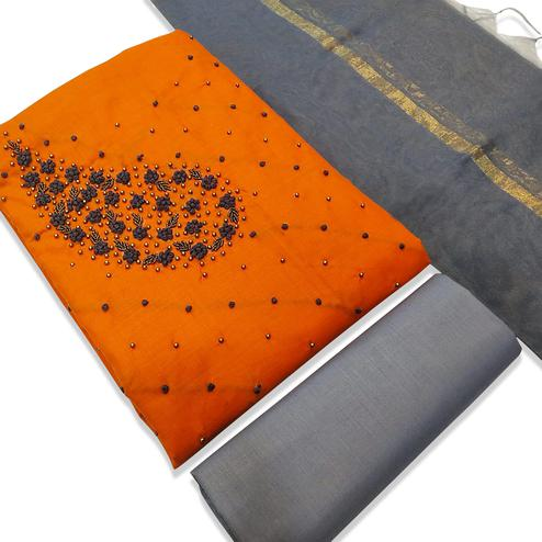 Entrancing Orange Colored Partyear Embroidered Modal Dress Material