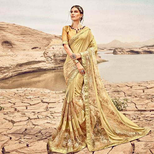 Blooming Golden Colored Partywear Embroidered Fancy Art Silk Saree